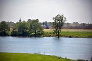 Nederland, the Netherlands, 9-5-2018Gebiedsontwikkeling Ooyen en Wanssum . Aanleg van een hoogwatergeul, nevengeul, in de rivier de Maas. Een van de projecten om ruimte voor het maaswater te geven . Grondverzet door Ploegam . Noord Limburg, grondwerk, kiepwagen,dragline,graafmachine,Foto: Flip Franssen