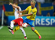 Lublin, Poland - 2017 June 19: (L) p13/fights for the ball with (R) Linus Wahlqvist from Sweden U21 while Poland v Sweden match during 2017 UEFA European Under-21 Championship at Lublin Arena on June 19, 2017 in Lublin, Poland.<br /> <br /> Mandatory credit:<br /> Photo by &copy; Adam Nurkiewicz / Mediasport<br /> <br /> Adam Nurkiewicz declares that he has no rights to the image of people at the photographs of his authorship.<br /> <br /> Picture also available in RAW (NEF) or TIFF format on special request.<br /> <br /> Any editorial, commercial or promotional use requires written permission from the author of image.