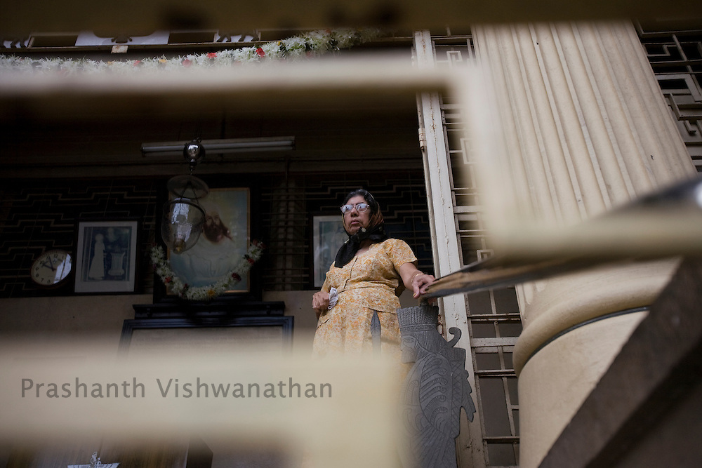 A Parsi woman leaves the Kappawala Agiary, or Fire Temple, on Navroze, the Parsi new year, in Mumbai, India, Tuesday, Aug. 19, 2008. Parsis, also known as Zoroastrians, worship fire and are followers of the Bronze Age Persian prophet Zarathustra. According to estimates there are only 150,000 Zoroastrians in the world today and more than 80,000 live in India, mostly in Mumbai. Photographer:Prashanth Vishwanathan/Atlas Press