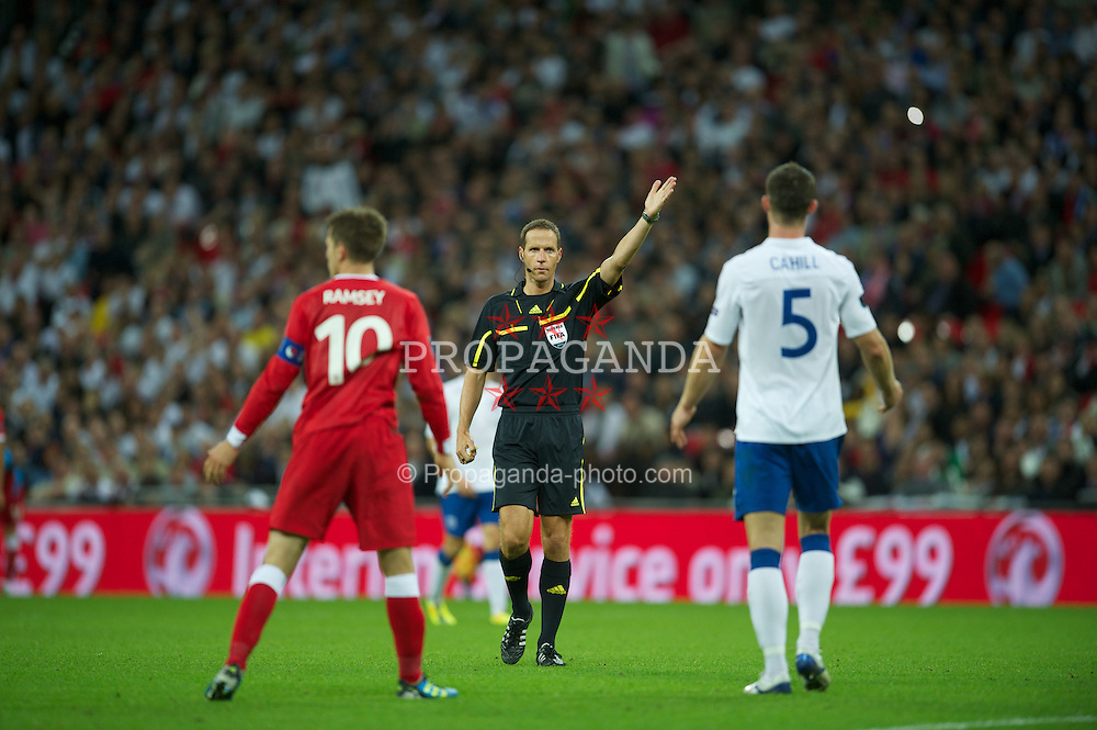 LONDON, ENGLAND - Tuesday, September 6, 2011: Referee Robert Schorgenhofer takes charge of England versus Wales during the UEFA Euro 2012 Qualifying Group G match at Wembley Stadium. (Pic by David Rawcliffe/Propaganda)