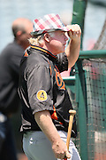 ANAHEIM, CA - MAY 4:  Buck Showalter #26 manager of the Baltimore Orioles tries on a promotional hat during batting practice before the game against the Los Angeles Angels of Anaheim on Saturday, May 4, 2013 at Angel Stadium in Anaheim, California. The Orioles won the game 5-4 in ten innings. (Photo by Paul Spinelli/MLB Photos via Getty Images) *** Local Caption *** Buck Showalter