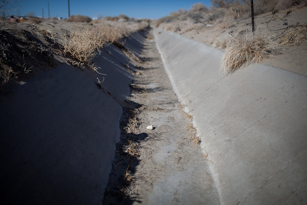An irrigation canal in April Brune's former neighborhood in Fallon, Nevada, February 5, 2014.