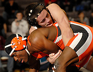 St. Charles West HIgh School wrestler Austin Rugraff (top) battles RItenour  High School's Lamar Welch in the finals of the 160-pound weight class at the St. Charles West wrestling tournament at St. Charles West High School in St. Charles Saturday, Jan. 14, 2011.  Photo © copyright 2012 Sid Hastings.