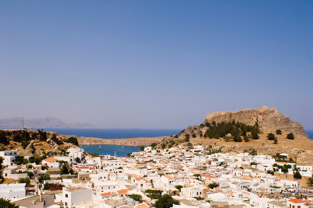 Typical Dodecanese style white houses and the Acropolis in Lindos, Rhodes,<br /> Dodecanese Islands, Greece