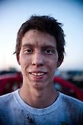 Chas Hartman, 20, stands in front of his car after finishing his last round in the demolition derby at the Fairgrounds in Valentine July 9, 2013. Photo by Lauren Justice