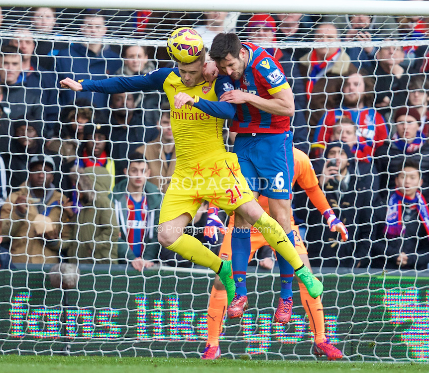 LONDON, ENGLAND - Saturday, February 21, 2015: Arsenal's Calum Chambers in action against Crystal Palace's captain Scott Dann during the Premier League match at Selhurst Park. (Pic by David Rawcliffe/Propaganda)