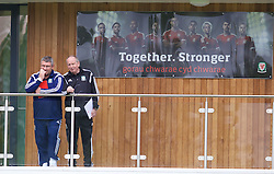 NEWPORT, WALES - Sunday, May 31, 2015: Wales' assistant manager Osian Roberts and Lennie Lawrence during the Football Association of Wales' National Coaches Conference 2015 at Dragon Park FAW National Development Centre. (Pic by David Rawcliffe/Propaganda)