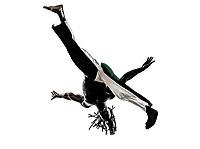 one black man dancer dancing capoeira on white background