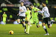 Brighton's Jamie Murphy battles with Derby County's Cyrus Christie during the Sky Bet Championship match between Derby County and Brighton and Hove Albion at the iPro Stadium, Derby, England on 12 December 2015. Photo by Shane Healey.