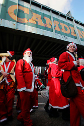 UK ENGLAND LONDON 16DEC06 - Revellers dressed as Santa Claus march through Camden Lock for the annual Santacon outing. Every December for the last 13 years, Cacophonous Santas have been visiting cities around the world, engaging in a bit of Santarchy as part of the annual Santacon events. . . It all started back in 1994 when several dozen Cheap Suit Santas paid a visit to downtown San Francisco for a night of Kringle Kaos. Things have reached Critical Xmas and Santarchy is now a global phenomenon.. . jre/Photo by Jiri Rezac. . © Jiri Rezac 2006. . Contact: +44 (0) 7050 110 417. Mobile:  +44 (0) 7801 337 683. Office:  +44 (0) 20 8968 9635. . Email:   jiri@jirirezac.com. Web:    www.jirirezac.com. . © All images Jiri Rezac 2006 - All rights reserved.