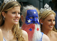 "Bob ""Popcorn Dude"" Henderson (middle) poses for a photograph with Fiesta Queens Lindsay Becker, Miss Vacaville Teen USA (right) and Vanessa Menendez, Miss Vacaville USA, after Henderson was presented with the ""Most Unique"" beard award by the queens at the ""Wiskerino"" beard contest during Fiesta Days."