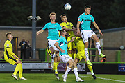 Forest Green Rovers Paul Digby(20) and Forest Green Rovers Nathan McGinley(19) jump for a cross during the EFL Trophy match between Forest Green Rovers and Cheltenham Town at the New Lawn, Forest Green, United Kingdom on 4 September 2018.