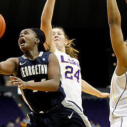November 16, 2011; Baton Rouge, LA; Georgetown Hoyas guard Sugar Rodgers (14) shoots past LSU Tigers forward Theresa Plaisance (24) and forward LaSondra Barrett (55) during the second half of a game at the Pete Maravich Assembly Center. LSU defeated Georgetown 51-40. Mandatory Credit: Derick E. Hingle-US PRESSWIRE