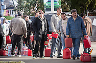 People wait for gas on Staten Isalnd after Hurrincane Sandy. Sandy took out power to millions and caused a gas shortage in the NY metropolitian area.