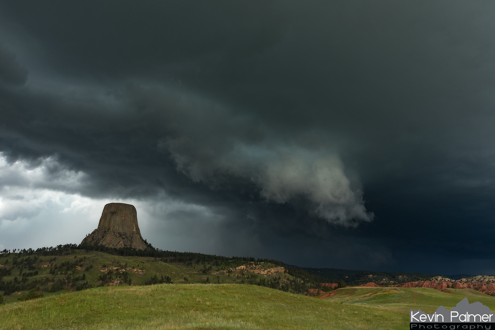 """On my way back from South Dakota I had a chance to intercept this severe storm at Devils Tower. I got there in time to watch the shelf cloud roll by over the tower. This storm was a prolific hail producer. I misjudged the movement of the storm and ended up getting caught on the edge of the hail core as I fled east towards Sundance. Golf ball-sized chunks of ice left additional dents in my car. But I got off easy, there were a lot of cars with smashed windshields. Hailstones up to 4.5"""" in size damaged crops further east where the storm also produced a tornado."""
