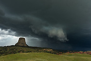 "On my way back from South Dakota I had a chance to intercept this severe storm at Devils Tower. I got there in time to watch the shelf cloud roll by over the tower. This storm was a prolific hail producer. I misjudged the movement of the storm and ended up getting caught on the edge of the hail core as I fled east towards Sundance. Golf ball-sized chunks of ice left additional dents in my car. But I got off easy, there were a lot of cars with smashed windshields. Hailstones up to 4.5"" in size damaged crops further east where the storm also produced a tornado."