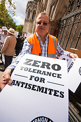"Royal Courts of Justice, London,  August 31st 2014. Placards are handed out as thousands of Jews and their supporters from London and across the UK demand ""Zero Tolerance for Antisemites"", organised by the Campaign Against Antisemitism."