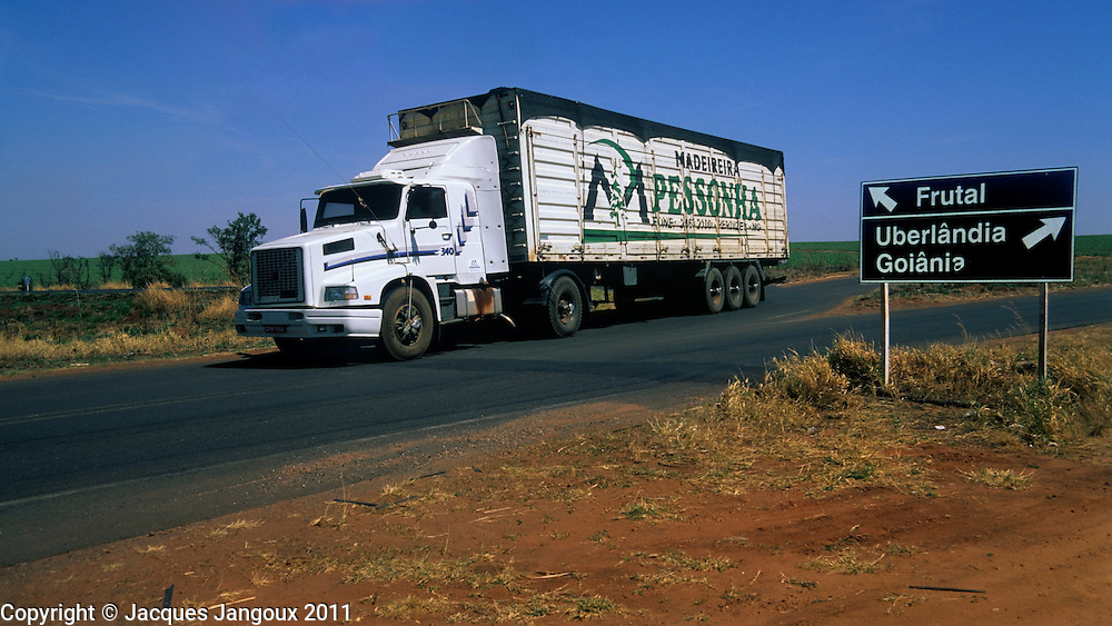 Road intersection in Minas Gerais, Brazil, with directions road sign and truck.