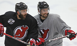 May 29; Newark, NJ, USA; New Jersey Devils center Adam Henrique (14) and New Jersey Devils defenseman Andy Greene (6) during Stanley Cup Finals media practice day at the Prudential Center.