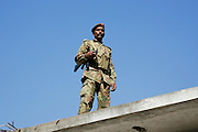 Armed Pakistani soldier on duty in village of Pattika, Pakistan