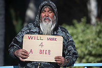 Portrait of senior homeless man with placard