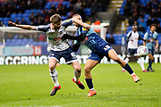 Wycombe Wanderers midfielder Curtis Thompson tackled by  Bolton Wanderers midfielder Luke Murphy during the EFL Sky Bet League 1 match between Bolton Wanderers and Wycombe Wanderers at the University of  Bolton Stadium, Bolton, England on 15 February 2020.