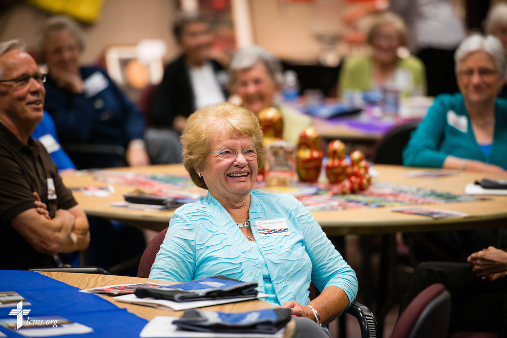 Lois Tormoehlen reacts with others during a lighthearted moment at the volunteer luncheon in the International Center of The Lutheran Church–Missouri Synod on Thursday, April 16, 2015, in Kirkwood, Mo. LCMS Communications/Erik M. Lunsford