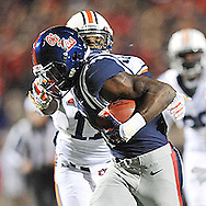 Ole Miss' wide receiver Laquon Treadwell (1) is tackled by Auburn Tigers' linebacker Kris Frost (17) and fumbles at Vaught-Hemingway Stadium in Oxford, Miss. on Saturday, November 1, 2014. Auburn won 35-31.(AP Photo/Oxford Eagle, Bruce Newman)