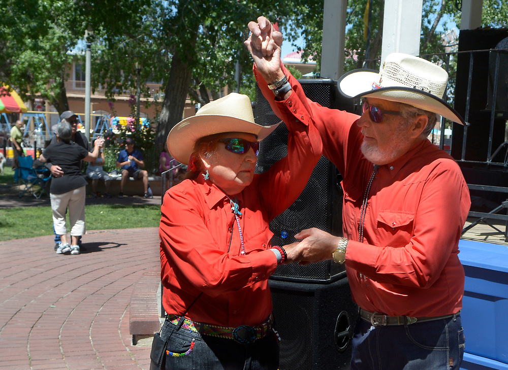 gbs060417b/ASEC -- Mercedes Ortega, left, and Ferman Lopez, both of Albuquerque, dance to the music of Mike Romero y La Raza in Old Town Plaza during the San Felipe de Neri Fiesta on Sunday, June 4, 2017. (Greg Sorber/Albuquerque Journal)
