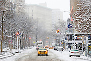 Yellow taxi cabs on Broadway, New York City, during a winter snowstorm.