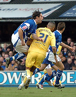 Photo: Ashley Pickering.<br />Ipswich Town v Sheffield Wednesday. Coca Cola Championship. 11/11/2006.<br />Ipswich's Alan Lee (blue) is body checked by Sheffield's Madjid Bougherra