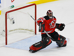 Dec 23, 2008; Newark, NJ, USA; New Jersey Devils goalie Scott Clemmensen (35) makes a blocker save during the second period at the Prudential Center.