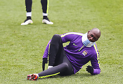 Manchester City's Eliaquim Mangala feigns an injury during the training session at the Etihad Campus ahead of the UEFA Champions League second leg match against FC Barcelona - Photo mandatory by-line: Matt McNulty/JMP - Mobile: 07966 386802 - 17/03/2015 - SPORT - Football - Manchester - Etihad Campus - Barcelona v Manchester City - UEFA Champions League