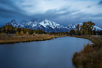 Schwabacher Landing in Grand Teton National Park during the blue hour just before sunrise on a cold Fall morning.