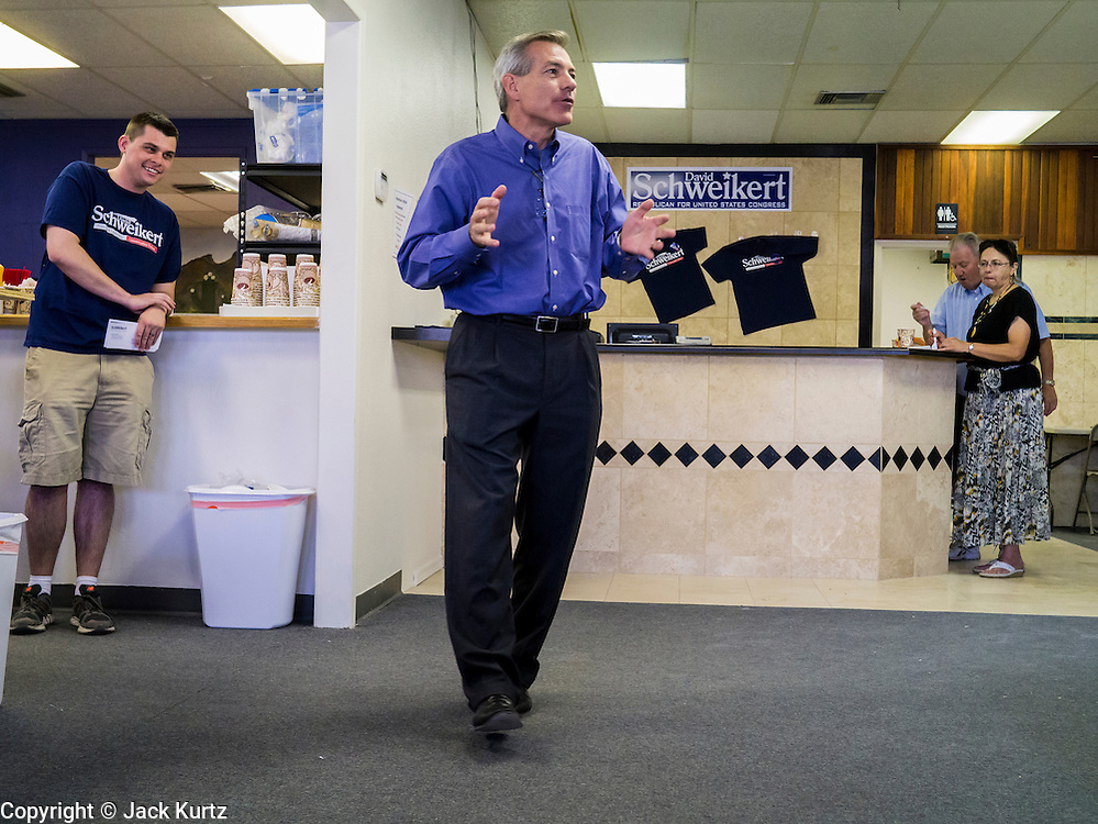 02 JUNE 2012 - PHOENIX, AZ:  Congressman DAVID SCHWEIKERT (R-AZ) makes impromptu comments to campaign volunteers Saturday. Schweikert met with his campaign staff and volunteers for a pancake breakfast Saturday morning at the campaign headquarters to talk to them about the upcoming primary election against fellow Republican Ben Quayle. Republican incumbents Schweikert and Quayle will face each other in Arizona's Aug. 28 primary election. Redistricting because of the census has thrown the two conservative freshman Republican Congressmen into Arizona's 6th Congressional District. The district is made up of mostly upper middle class neighborhoods in north Phoenix and the wealthy suburban communities of Scottsdale, Fountain Hills and Cave Creek. The District is strongly Republican and whoever wins the Republican primary is expected to easily win November's general election.       PHOTO BY JACK KURTZ