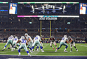 Dallas Cowboys quarterback Dustin Vaughan (10) hands off the ball on a running play to Dallas Cowboys running back Gus Johnson (37) in this wide angle photograph that shows the end zone and the scoreboard on the other side of the field during the 2015 NFL preseason football game against the Houston Texans on Thursday, Sept. 3, 2015 in Arlington, Texas. The Cowboys won the game 21-14. (©Paul Anthony Spinelli)
