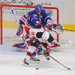 May 16, 2012: New York Rangers defenseman Marc Staal (18) checks New Jersey Devils left wing Zach Parise (9) in front of the Rangers' goal during third period action in game 2 of the NHL Eastern Conference Finals between the New Jersey Devils and New York Rangers at Madison Square Garden in New York, N.Y. The Devils defeated the Rangers 3-2.