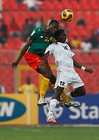 Photo: Steve Bond/Richard Lane Photography.<br /> Cameroun v Zambia. Africa Cup of Nations. 26/01/2008. Joseph Desire Job (L) gets the ball above Billy Mwanza (R)