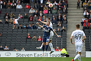 Milton Keynes Dons defender Joe Walsh (4) heads the ball under pressure from Southend United defender Jason Demetriou (24) during the EFL Sky Bet League 1 match between Milton Keynes Dons and Southend United at stadium:mk, Milton Keynes, England on 22 October 2016. Photo by Dennis Goodwin.