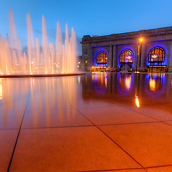 Kansas City's Union Station and fountain on Pershing Road, with the station lit in Royal Blue light for Kansas City Royals in 2014 Major League Baseball World Series.