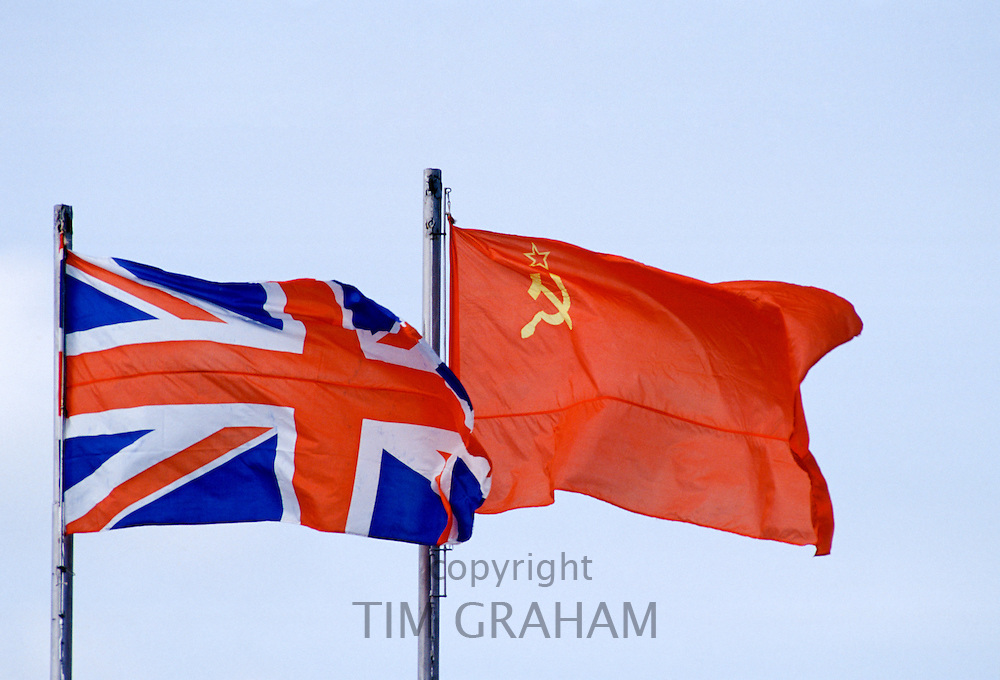 Hammer and Sickle flag alongside British Union Jack flag flying in Moscow, Russia