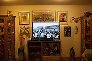 A video from a Hopi social dance plays on large flat screen in the living room of Watson and Sarah Honanie's Hotevilla home.