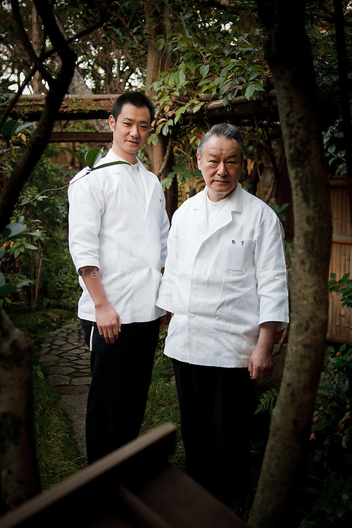 Kyoto, December 17 2010 - At the Kaiseki restaurant Hyotei in Kyoto. Portrait of the chefs, Eiichi Takahashi (right) and Yoshihiro Takahashi (left), respectively father and son, in the garden of the restaurant.