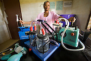 A medical worker shows equipment used for reviving newborns at the Adja-Ouere community health center in the village of Adja-Ouere, Benin on Friday September 14, 2007. Some of the equipment is sponsored by unicef.