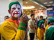 06 FEBRUARY 2014 - HAT YAI, SONGKHLA, THAILAND: Folk dancers wait to perform during Lunar New Year on a main street in Hat Yai. Hat Yai was originally settled by Chinese immigrants and still has a large ethnic Chinese population. Chinese holidays, especially Lunar New Year (Tet) and the Vegetarian Festival are important citywide holidays.     PHOTO BY JACK KURTZ