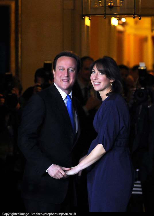 © under license to London News Pictures. 11/05/10. David Cameron and his wife Samantha turn back to look at the media as they enter Number 10 Downing Street after he became British Prime Minister. British Prime Minister Gordon Brown has resigned his position and David Cameron has become the new British Prime Minister on May 11, 2010. The Conservative and Liberal Democrats are to form a coalition government after five days of negotiation. Photo credit should read Stephen Simpson/LNP
