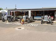 Old cars and Massey Ferguson tractors on display at Stonham Barns, Suffolk, England, UK