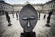 UNITED KINGDOM, London: 4 October 2016 An installation by artist Zak Ove, of a Nubian army of masked men, stands in the courtyard at Somerset House in London, Tuesday, Oct. 4, 2016. The unveiling of Ove's resin and jesmonite statues marks the launch of the 1 54 Contemporary African Art Fair. Andrew Cowie / Story Picture Agency