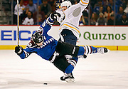 SHOT 3/28/15 7:29:21 PM - The Colorado Avalanche's Gabriel Landeskog #92 goes airborne after colliding with the Buffalo Sabres'  Nicolas Deslauriers #44 during their regular season NHL game at the Pepsi Center in Denver, Co. The Avalanche won the game 5-3. (Photo by Marc Piscotty / © 2015)