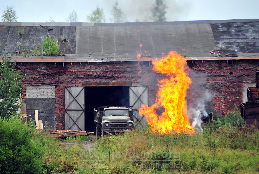 A burnoff at a canalside factory approaching Lake Beloye, part of a 700 mile cruise from St. Petersburg along the Volga-Baltic Waterway to Moscow, Russia.